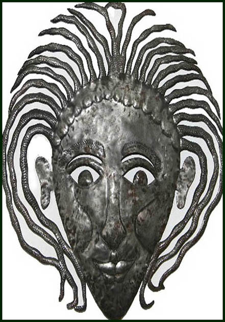 Steel drum metal sculpture. Haitian mask design.