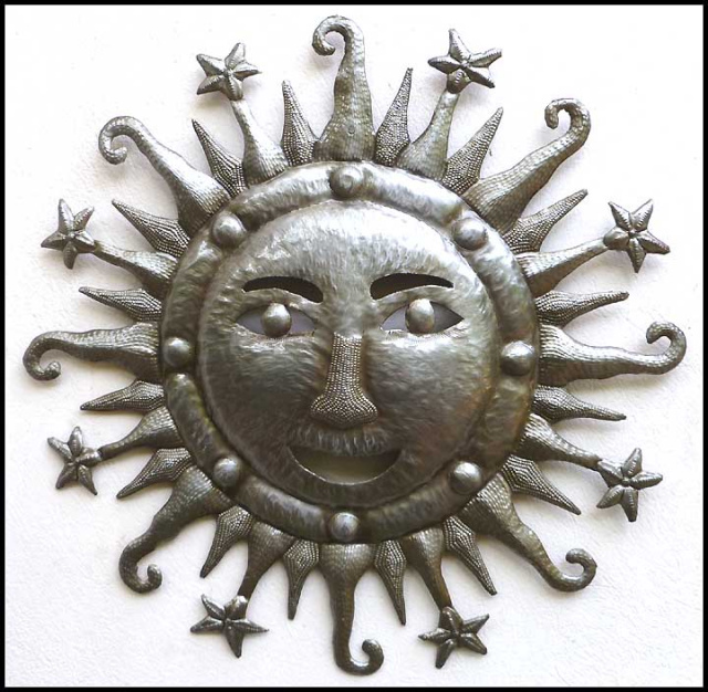 metal sun wall hanging . Haitian recycled steel drum design.