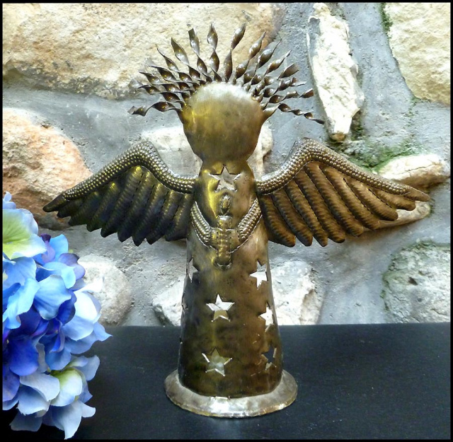 Angel design metal candle holder. Haitian metal art