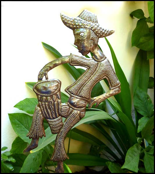 Haitian Peasant metal garden plant stake. Hand hammered, recycled steel drum from Haiti.